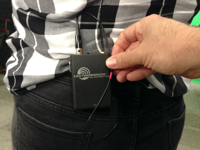 Placing the transmitter pack on the back of the pants